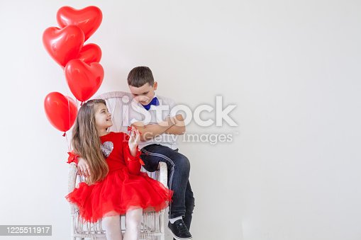 istock Children with red heart-shaped balloons at the holiday 1225511917