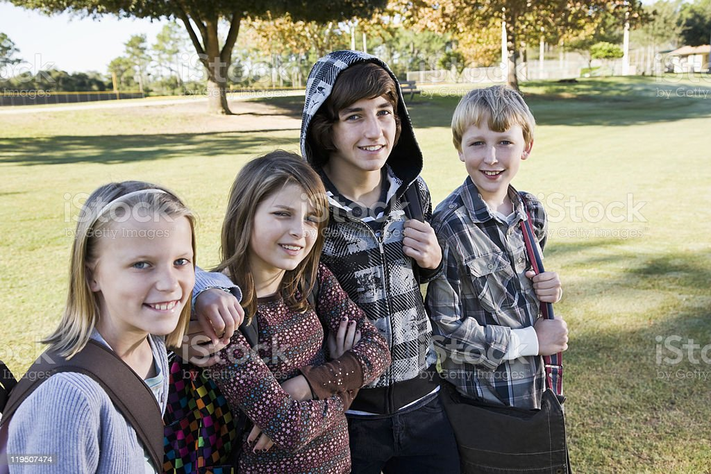Children with school backpacks royalty-free stock photo