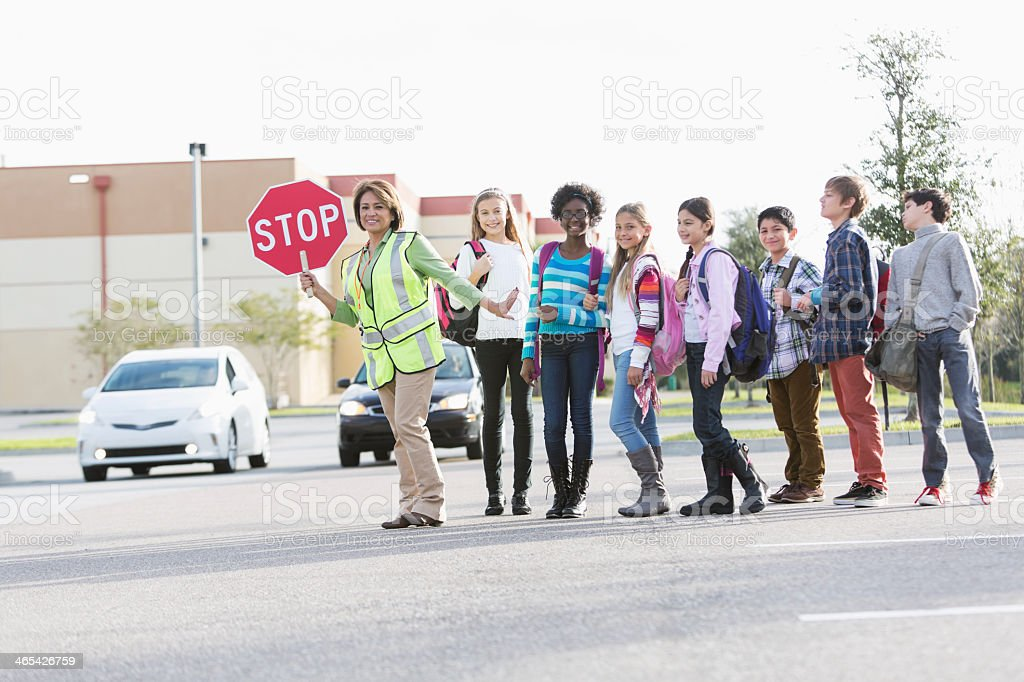 Children with school crossing guard stock photo