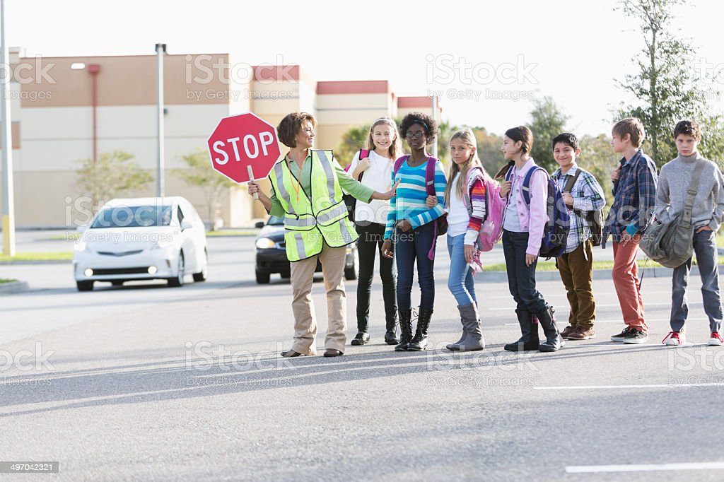 Children with school crossing guard stock photo