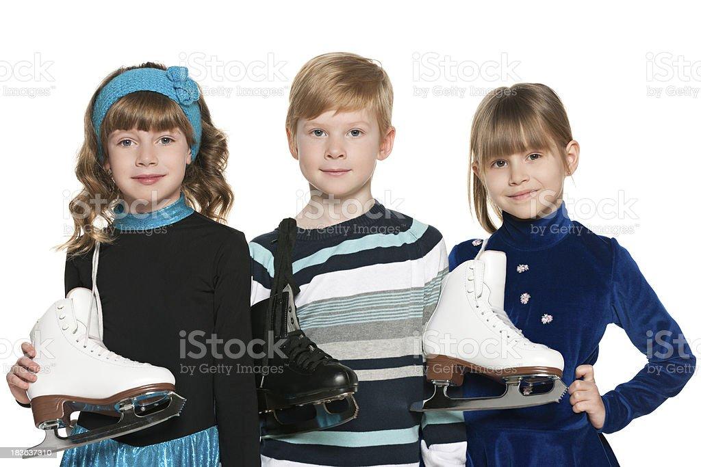 Children with skates stock photo