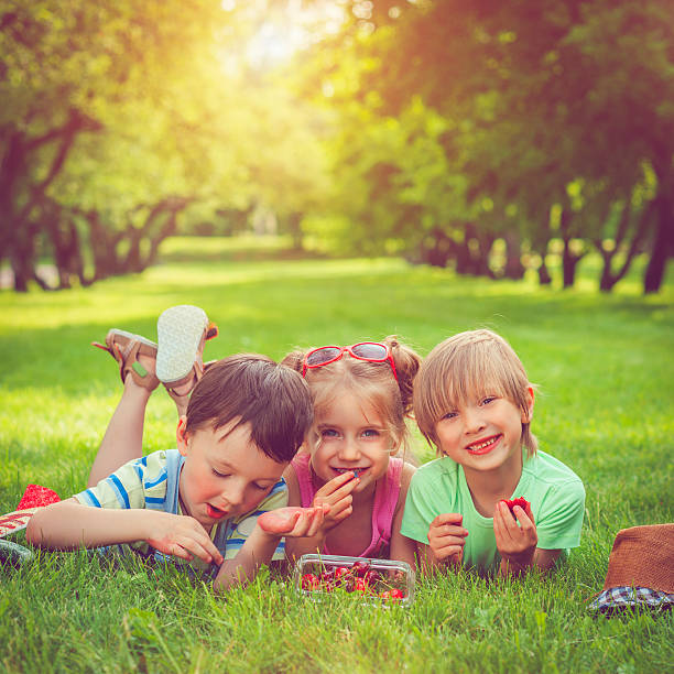children with summer berries - food allergies stock photos and pictures