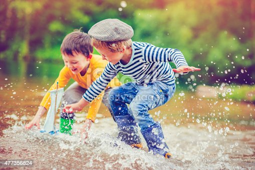 istock Children with toy ship 477356824