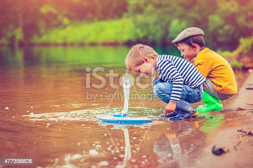 istock Children with toy ship 477356826