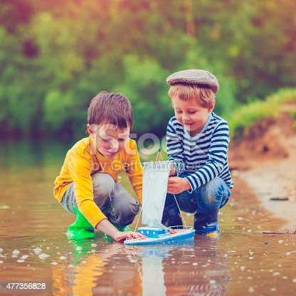 istock Children with toy ship 477356828