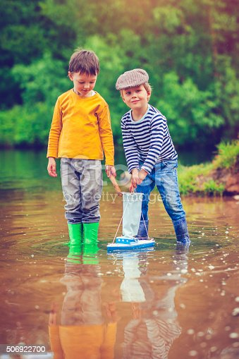 istock Children with toy ship 506922700