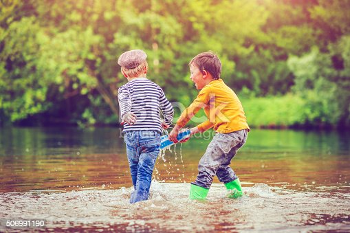 istock Children with toy ship 506991190