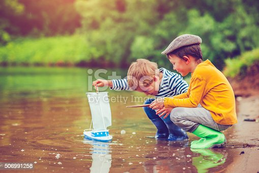 istock Children with toy ship 506991258