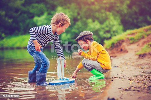 istock Children with toy ship 506991432
