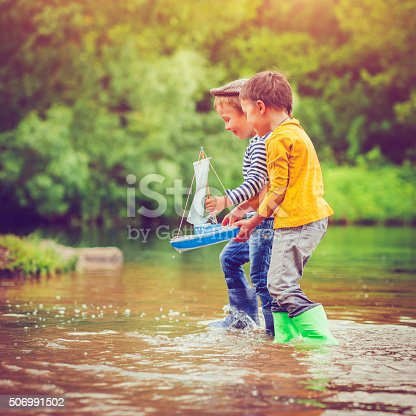 istock Children with toy ship 506991502