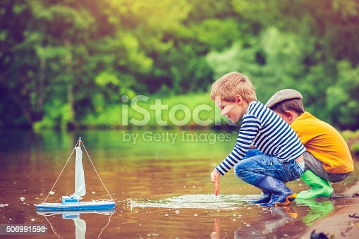 istock Children with toy ship 506991598