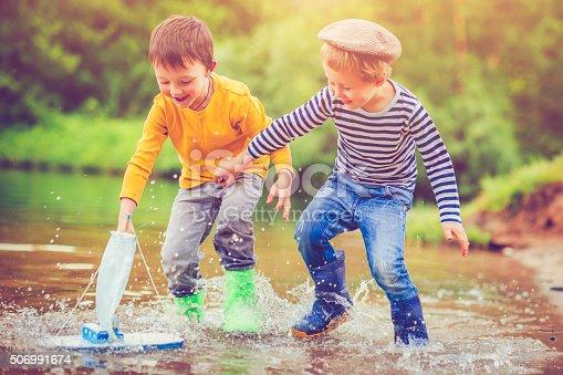 506991764istockphoto Children with toy ship 506991674