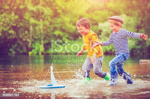 istock Children with toy ship 506991764