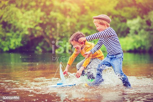 istock Children with toy ship 506991886