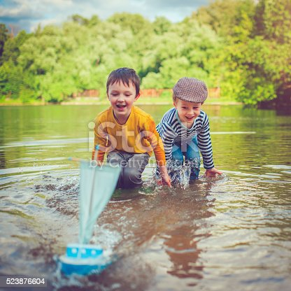 istock Children with toy ship 523876604