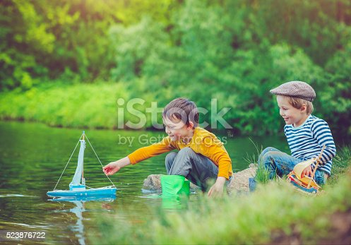 istock Children with toy ship 523876722