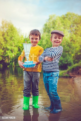 istock Children with toy ship 523876828