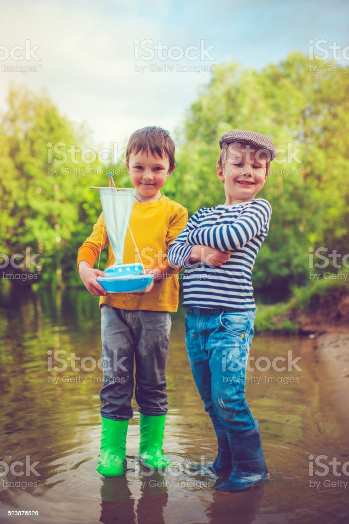 Children with toy ship stock photo