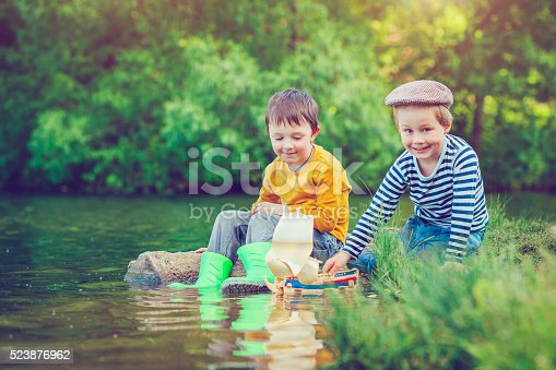 istock Children with toy ship 523876962