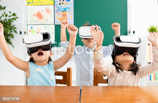 682285886 istock photo children with virtual reality headset in classroom 900075790