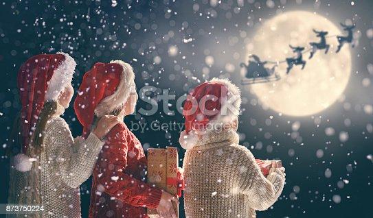istock children with xmas presents 873750224