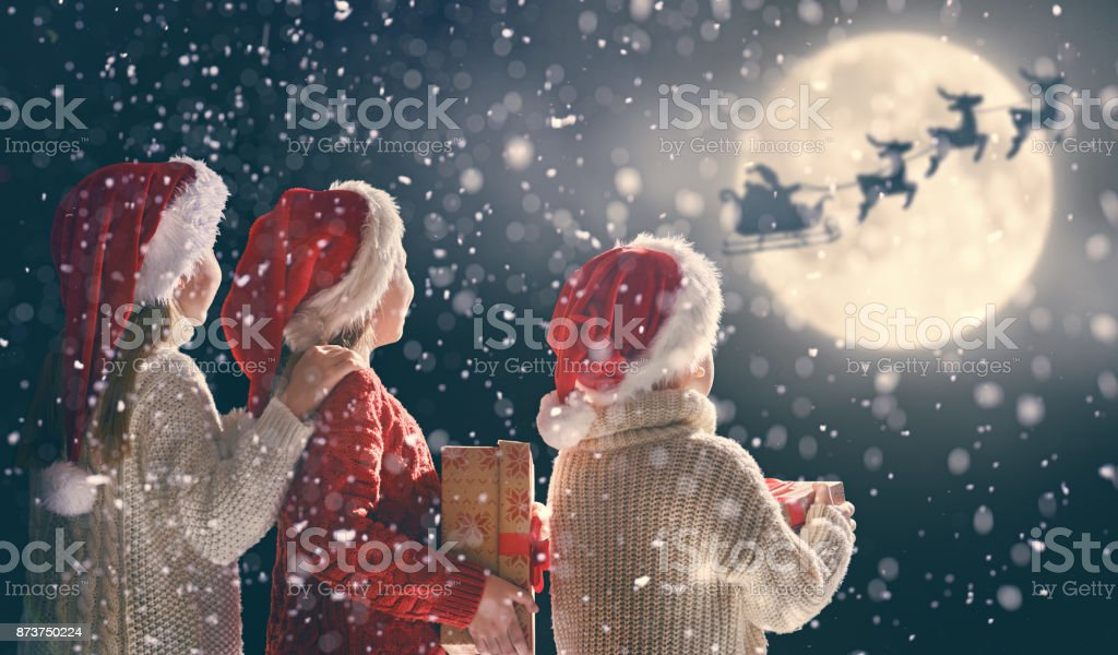 children with xmas presents stock photo