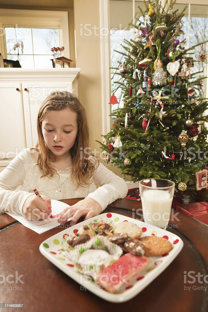 Children Writing Christmas Wish List and Offering Treats to Santa royalty-free stock photo
