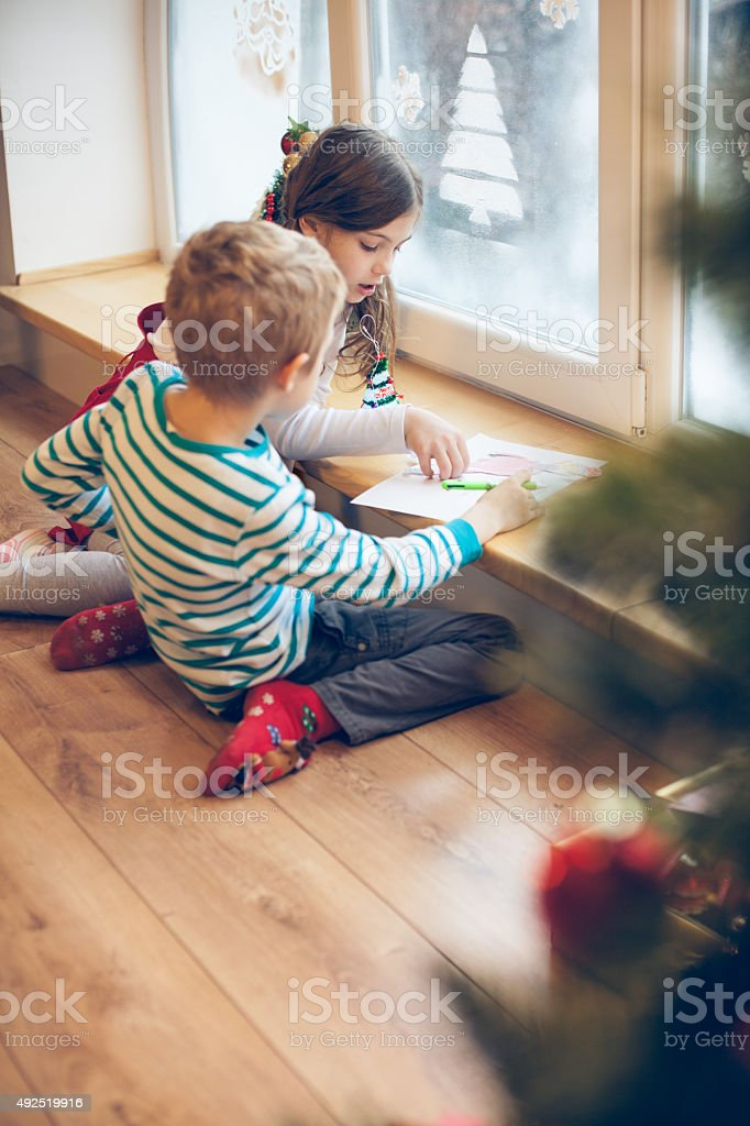 Children writing letter to Santa stock photo