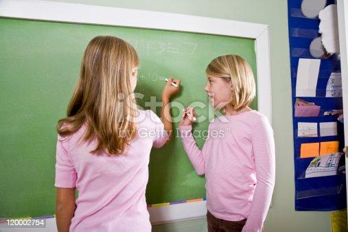 istock Children writing on blackboard in classroom 120002754