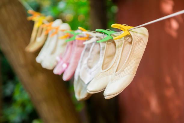 Children's ballet shoes are drying on a rope