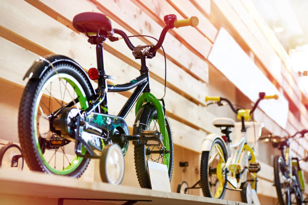 Childrens bicycles in sport shop Childrens bicycles in a sports shop bicycle shop stock pictures, royalty-free photos & images