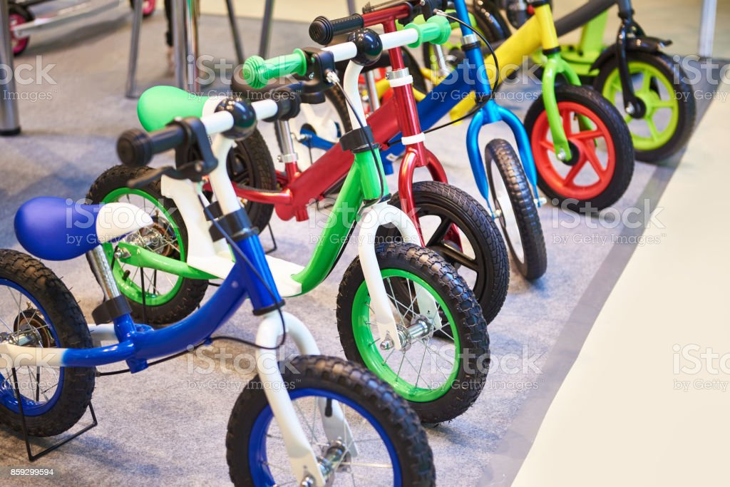 Children's bicycles in store stock photo