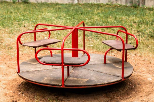 Children's carousel in the park stock photo