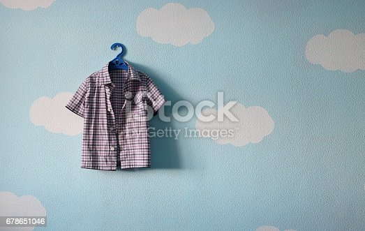 678651100 istock photo children's clothes hanging on a hanger against the wall of bubbles 678651046