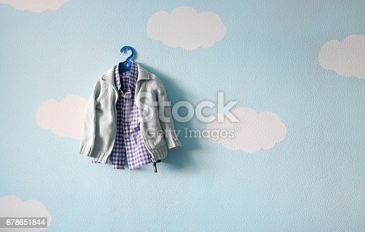 istock children's clothes hanging on a hanger against the wall of bubbles 678651844