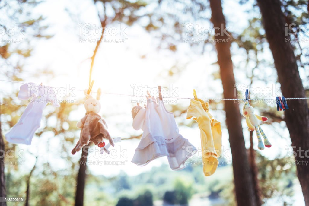 children's clothing for girls outdoors in the garden stock photo