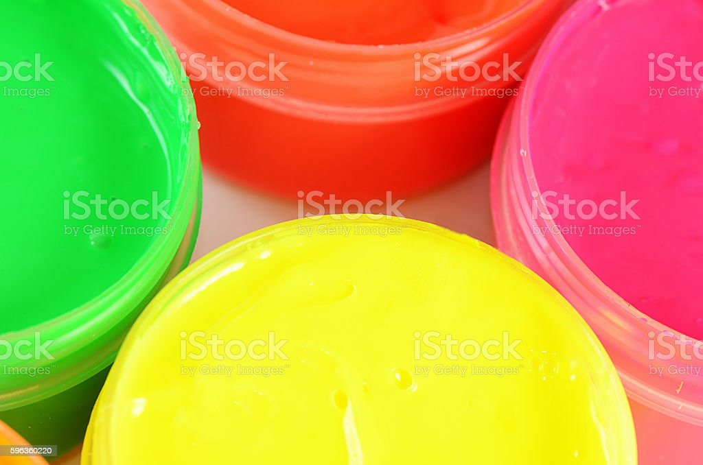 Children's colorful finger paints in jars royalty-free stock photo