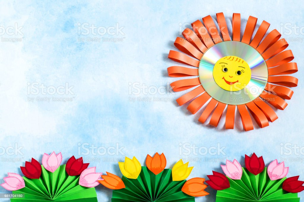 Childrens Crafts Made Of Paper And Cd Sun And Flowers Stock Photo