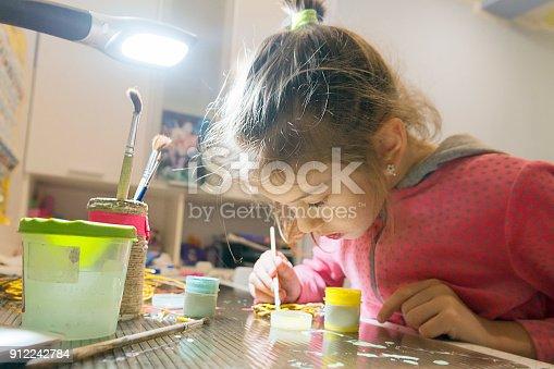 istock Children's creativity.The child decorates the garland. 912242784