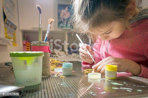istock Children's creativity.The child decorates the garland. 912242806