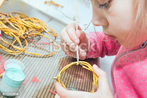 istock Children's creativity.The child decorates the garland. 912242808