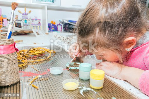 istock Children's creativity.The child decorates the garland. 912242818