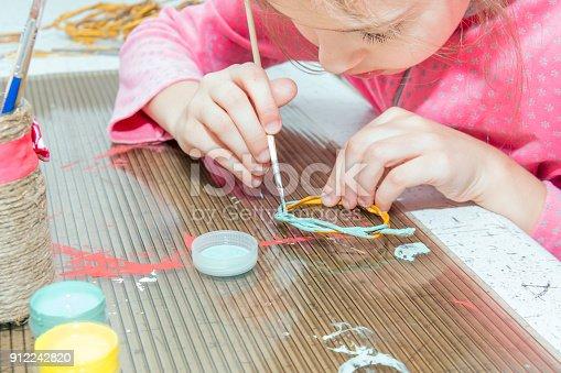 istock Children's creativity.The child decorates the garland. 912242820