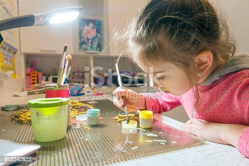 istock Children's creativity.The child decorates the garland. 912242822
