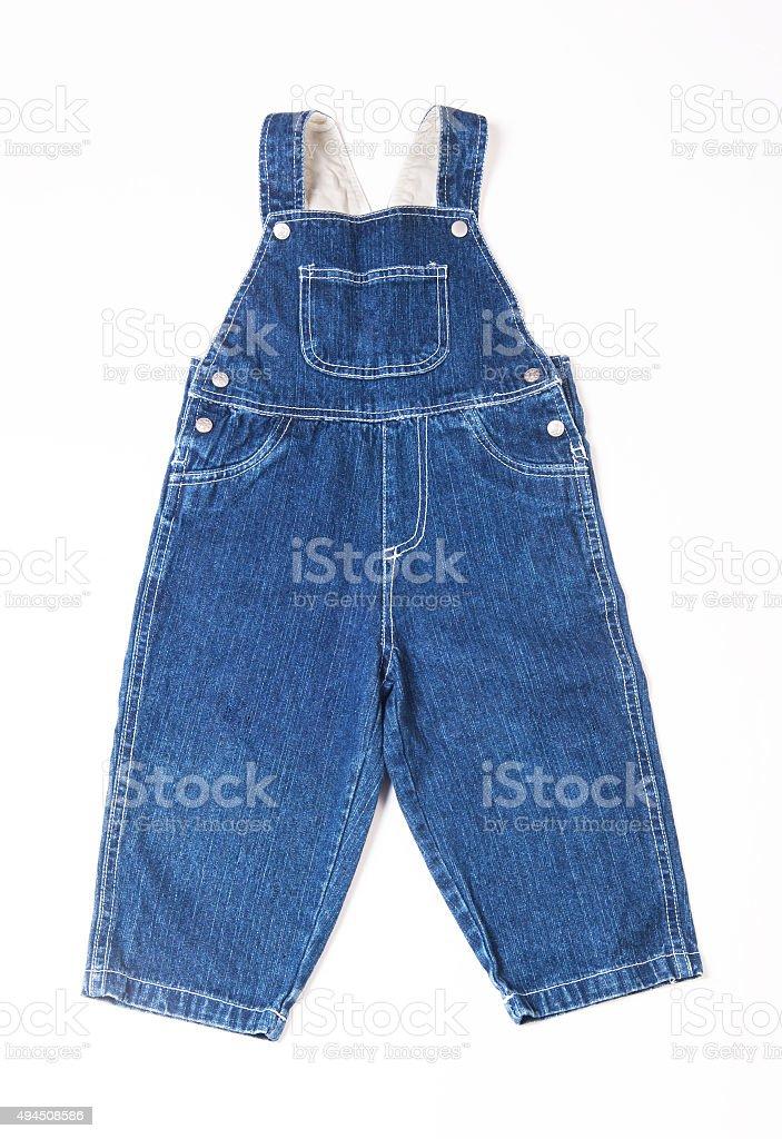 Children's denim overalls stock photo