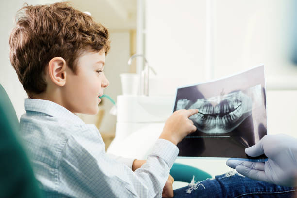 Children's dentistry. A child in the dental office stock photo