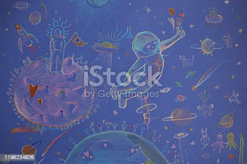 istock Children's drawing on a blue paper. Cosmos motives. 1196234626