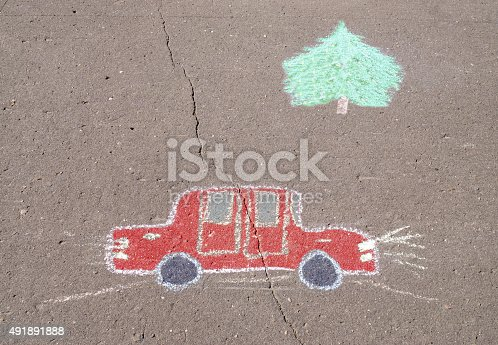 istock Children's drawing with chalk of car 491891888