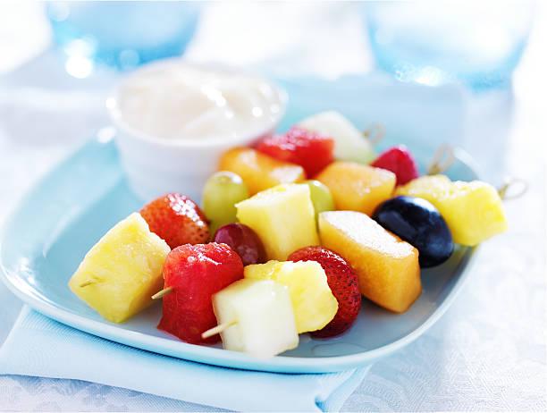 children's fruit kabob with vanilla yogurt stock photo