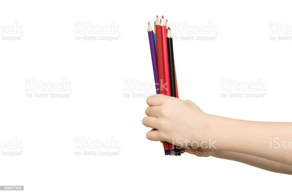 İzole renkli kalem tutan çocuk el stok fotoğrafı